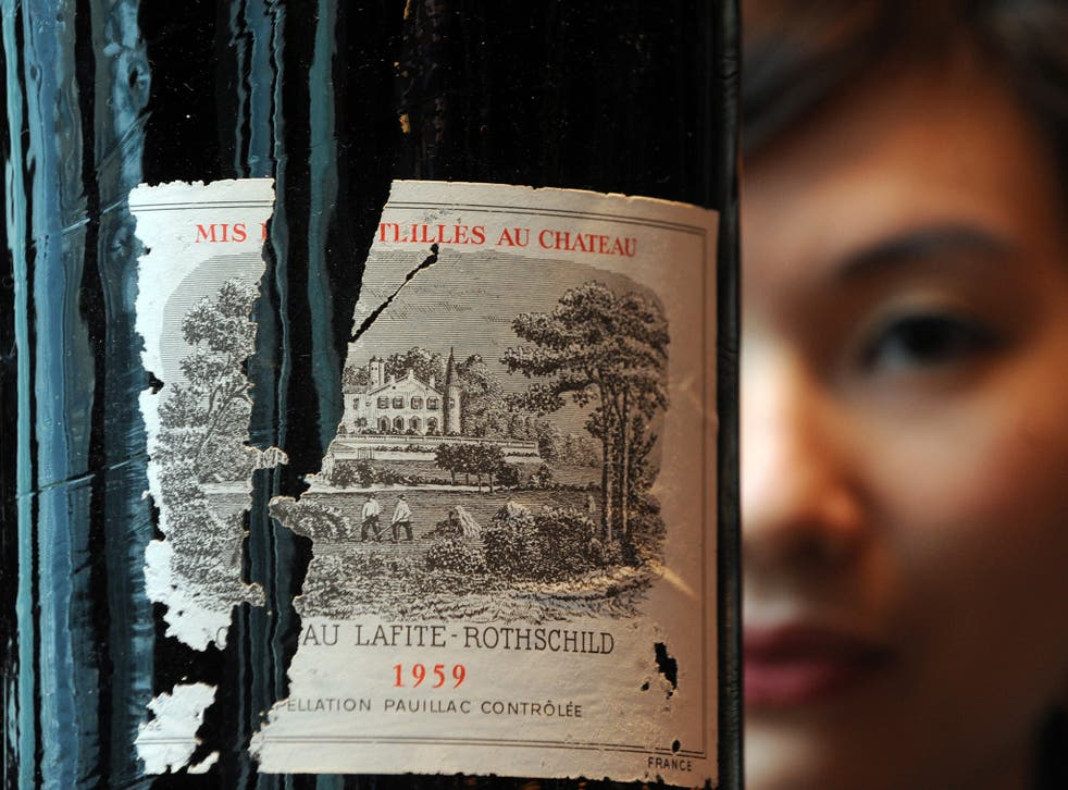 A bottle of Chateau Lafite Rothschild 1959 at an auction preview in Hong Kong