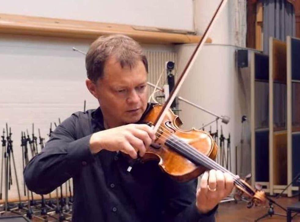 Stephen Morris playing his violin