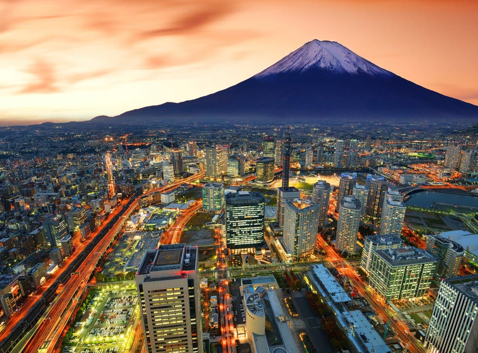 Mount Fuji looms in the background of Yokohama