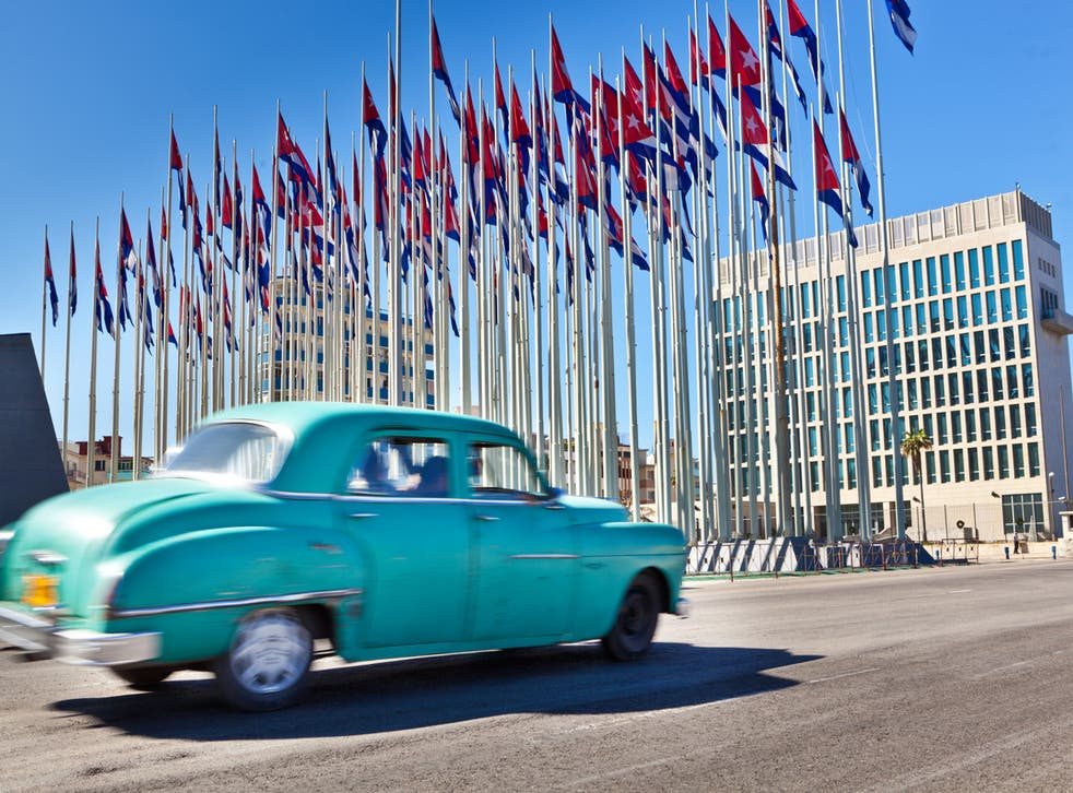 The US embassy in Havana seen behind an array of Cuban flags. In all, 26 US diplomatic staff suffered the effects of 'Havana syndrome'