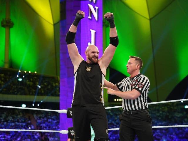 Tyson Fury celebrates his win over Braun Strowman