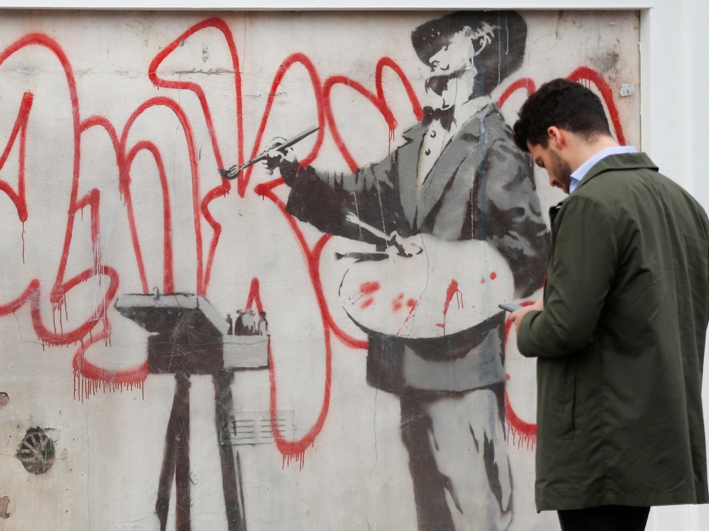 Banksy: Street artist's 2008 mural uncovered in London's Notting Hill