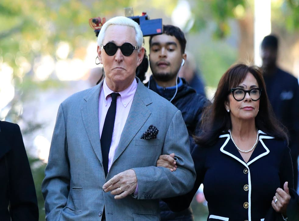 Roger Stone, flanked by his wife Nydia Stone, arrives at the federal court in Washington DC for the first day of his trial