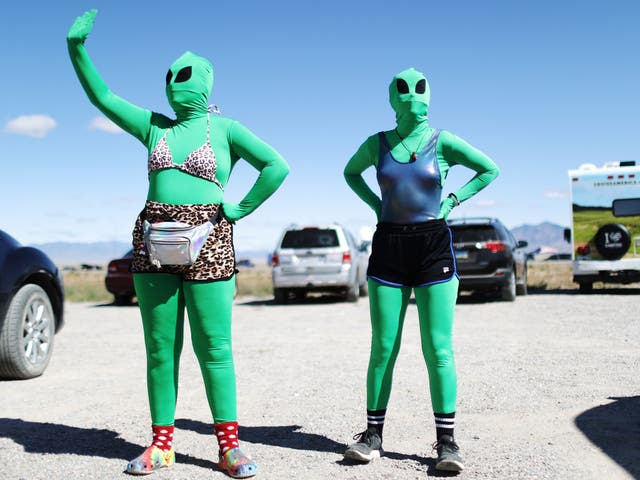 Women dressed as aliens at a Storm Area 51 spinoff event called Alienstock on 20 September in Rachel, Nevada
