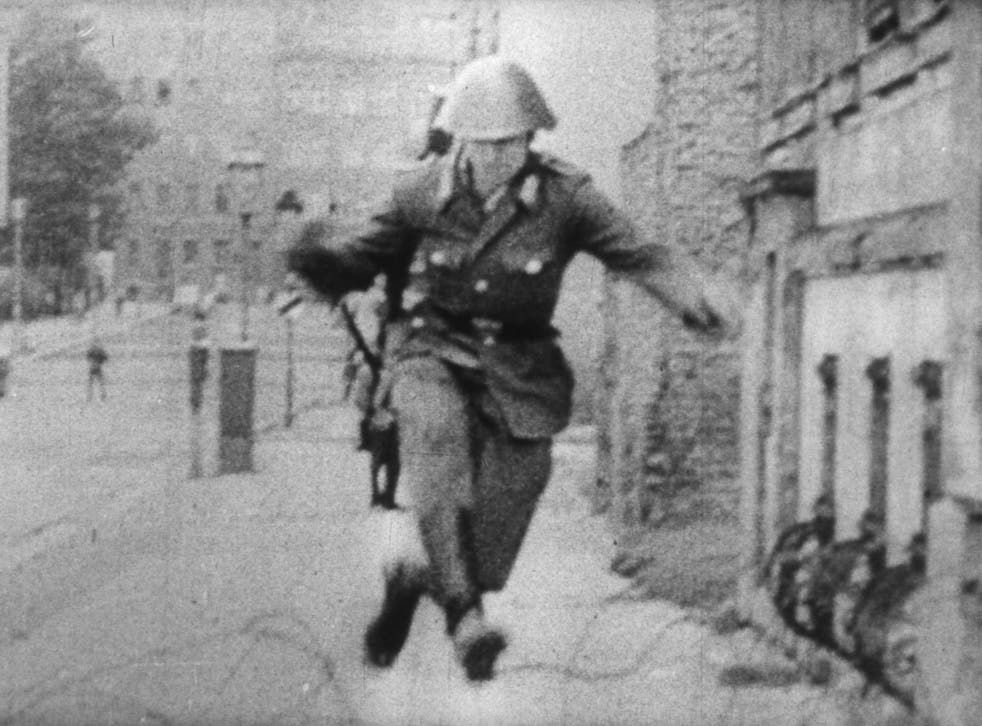 The image of East German border guard Conrad Schumann fleeing to West Germany made international front pages