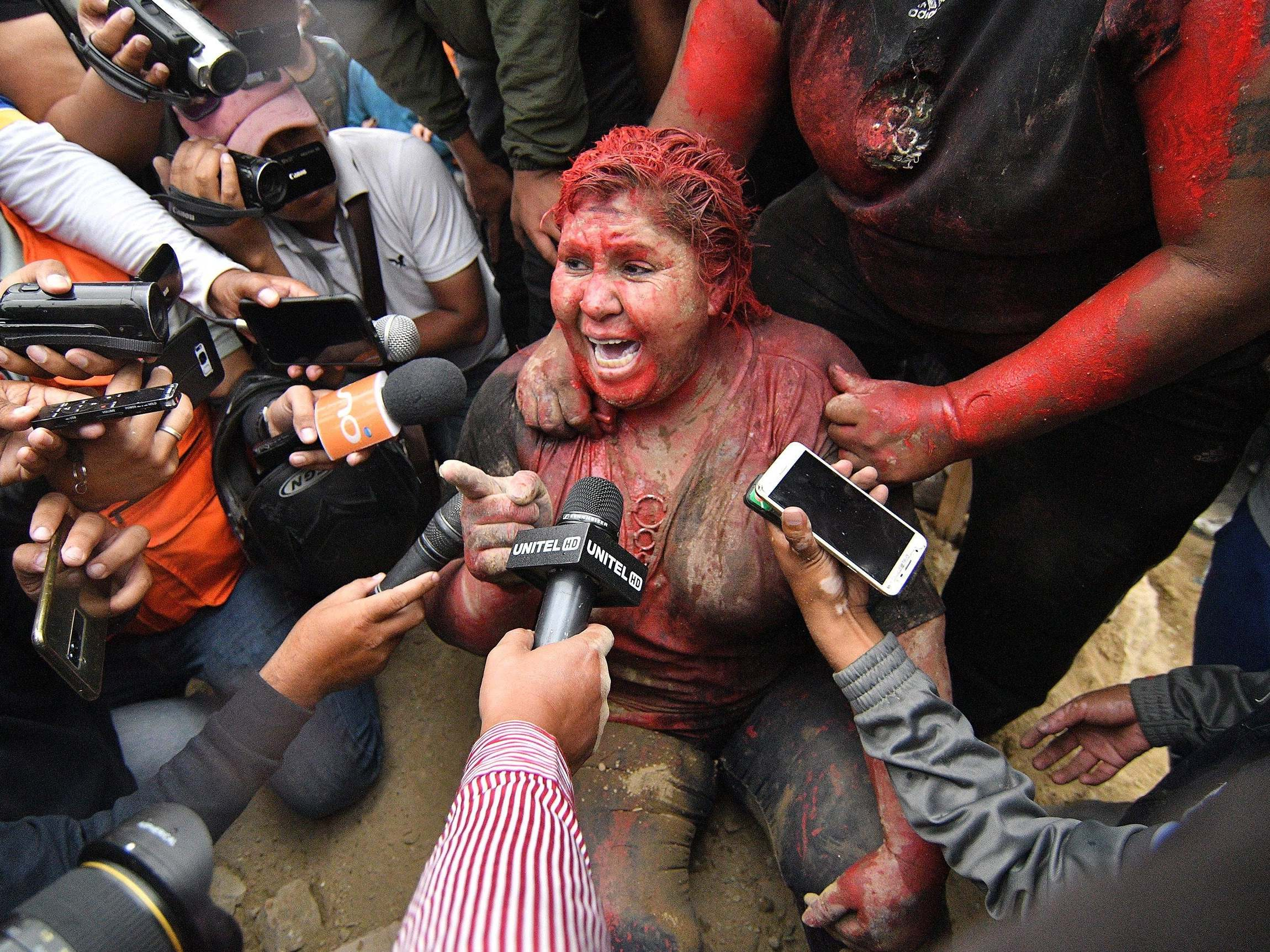 Image result for Bolivia: Protesters cut off mayor's hair, cover her in red paint and drag her through the streets