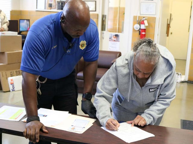 Grandmother Geneva Cooley signs papers to be released from Julia Tutwiler Prison