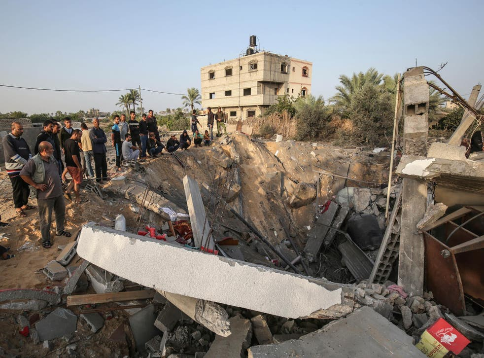 Palestinians check the remains of a house destroyed in an Israeli airstrike at Khan Yunis, in the southern Gaza Strip, on 13 November 2019