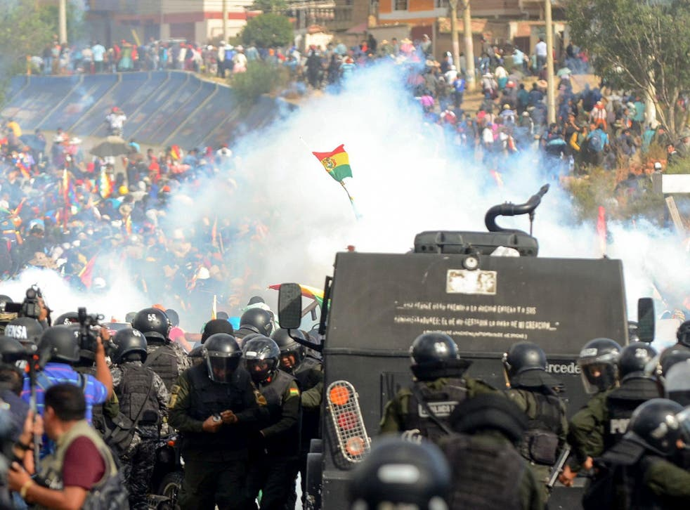 Bolivian riot police clash with supporters of Evo Morales during a protest against the interim government in Sacaba