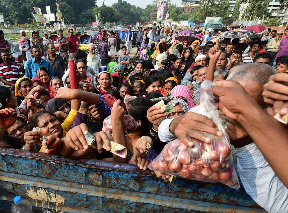 People attempt to buy subsidised onions in Dhaka over the weekend