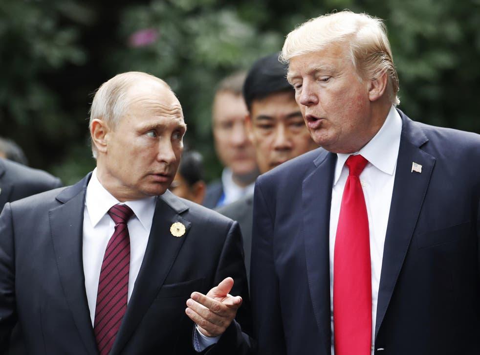 Donald Trump towers over Russian president Vladimir Putin