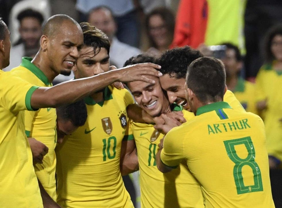 Brazil celebrate after Philippe Coutinho scores in Abu Dhabi