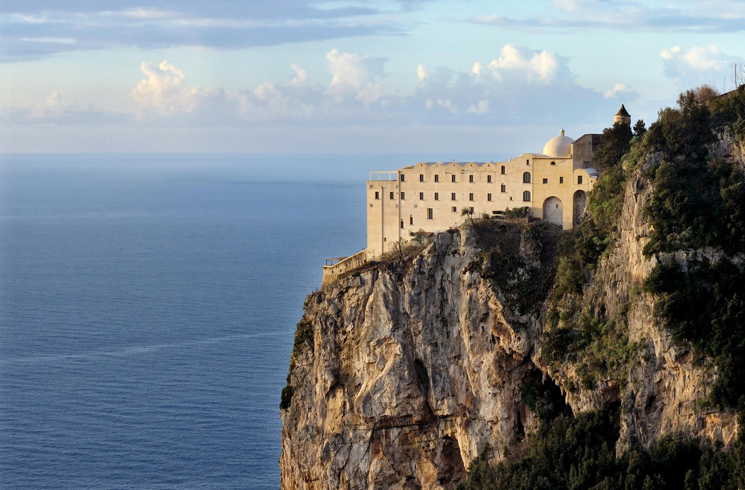 A converted 17th century monastery hanging off a cliffside has become one of the most breathtaking hotels in Italy