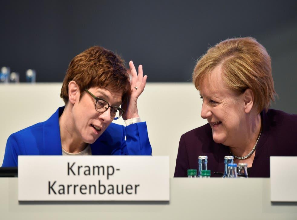 Angela Merkel talks to party chairwoman Annegret Kramp-Karrenbauer during the Christian Democratic Union (CDU) party congress in Leipzig