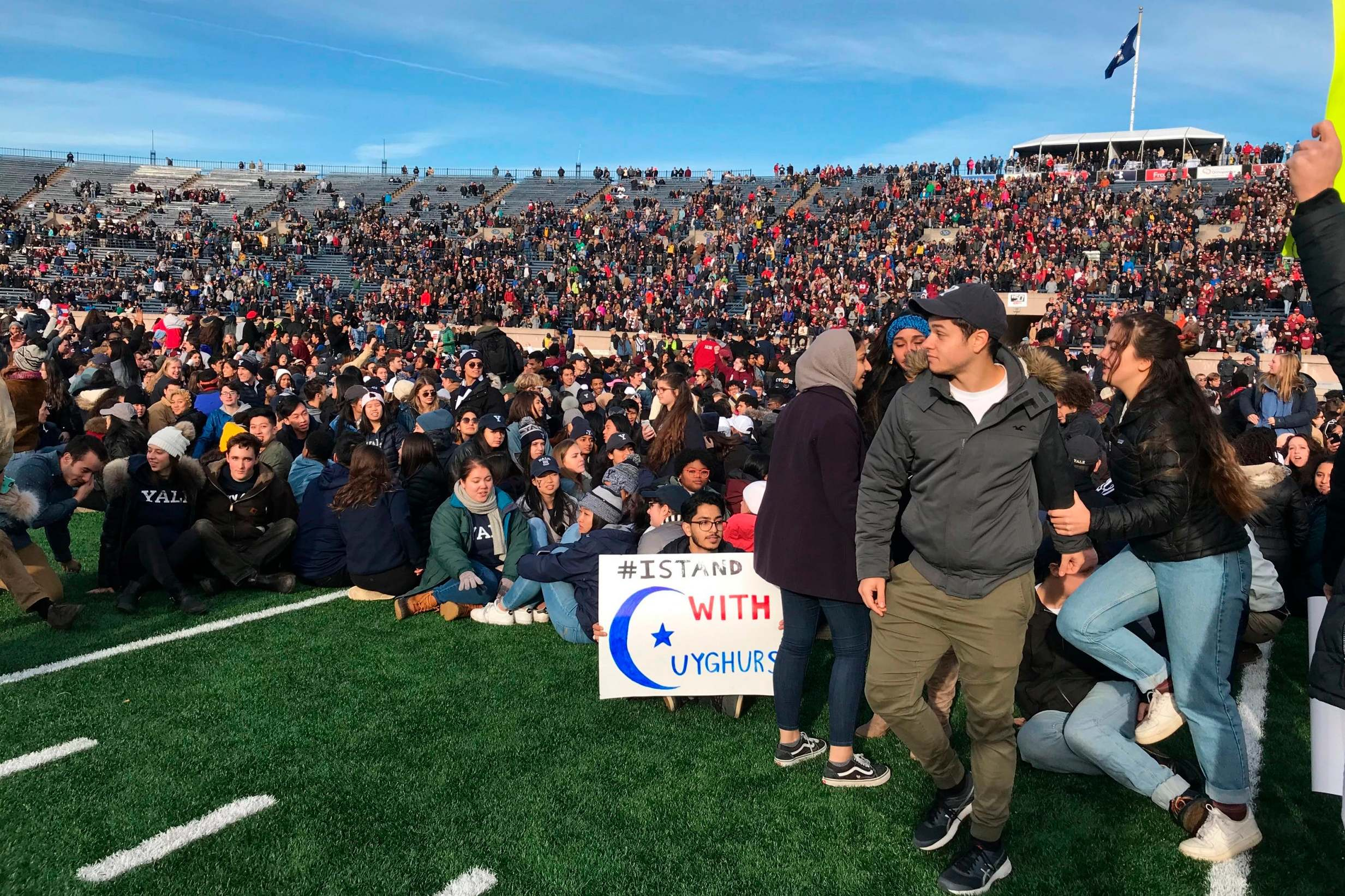 Harvard-Yale football game grinds to halt as hundreds of students storm field to protest climate change