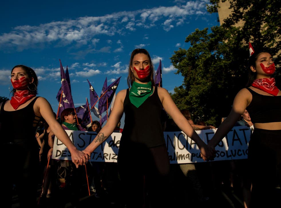Activists take part in a march on the eve of the commemoration of the International Day for the Elimination of Violence Against Women, in Santiago, on 22 November 2018.