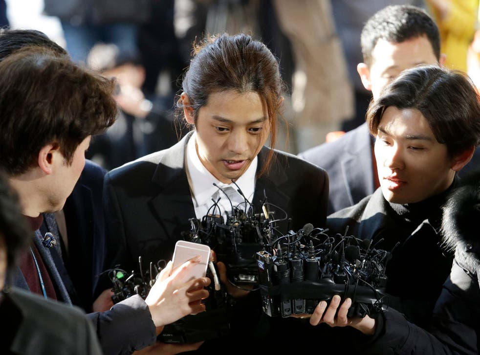 K-pop singer Jung Joon-young, pictured here arrives at Seoul Metropolitan Police Agency in South Korea in March, was jailed for six years on 29 November for rape and sharing videos he secretly filmed during sex with women