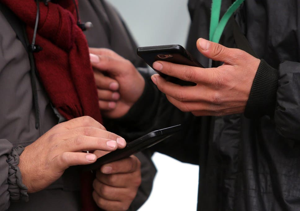 Iranians, pictured on their phones in Tehran, are struggling to adjust to life offline