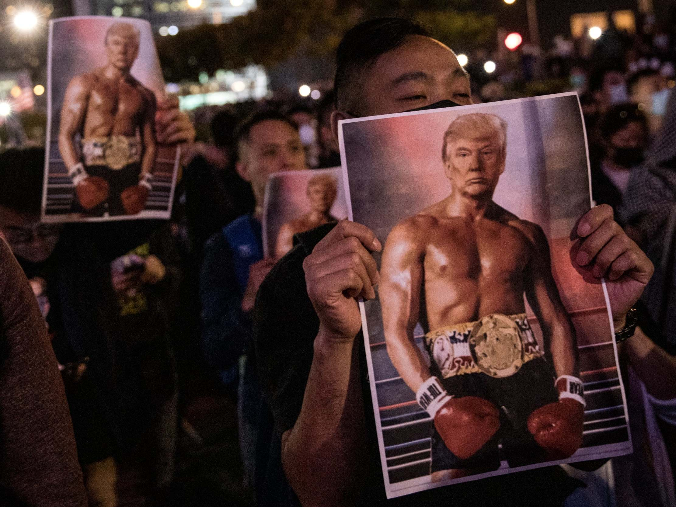 Hong Kong protesters wave posters of Trump's shirtless Rocky tweet to thank him for signing law supporting them