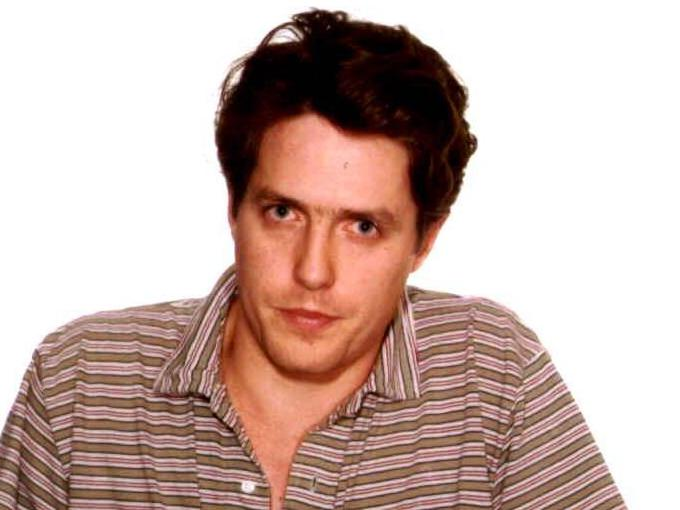 Hugh Grant shares infamous photo of himself with sex worker to hit back at critics: 'To my dear trolls'