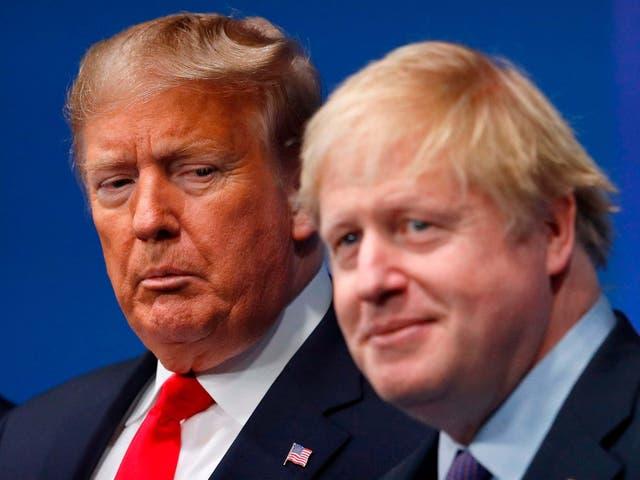 Britain's Prime Minister Boris Johnson (R) welcomes US President Donald Trump (L) to the NATO summit