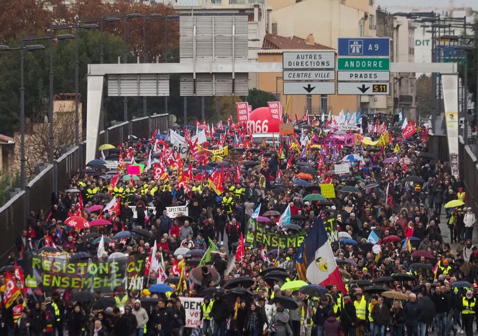 People protest against the pension overhauls, in Perpignan, southern France, on 5 December 2019 as part of a national general strike