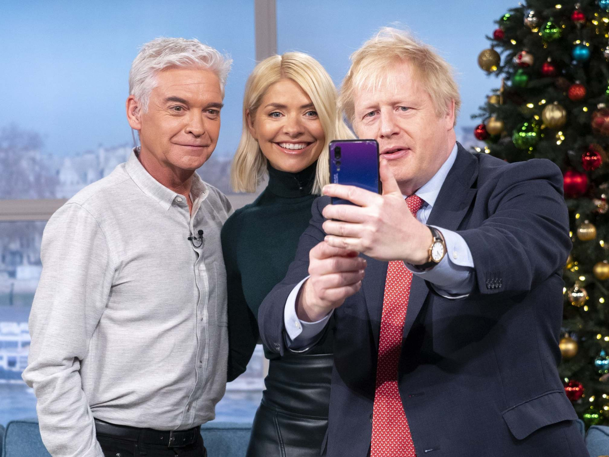 Boris Johnson sparks national security fears after being spotted using Huawei phone