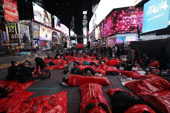 New Yorkers sleep in Times Square to raise funds for homeless charity