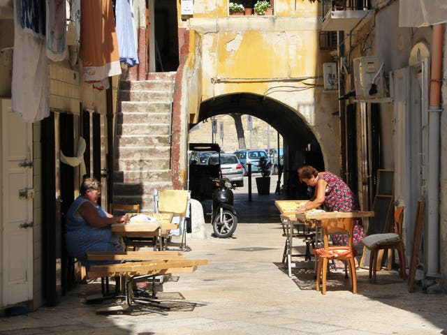 Pasta makers work out in the sun on Arco Basso in Old Bari