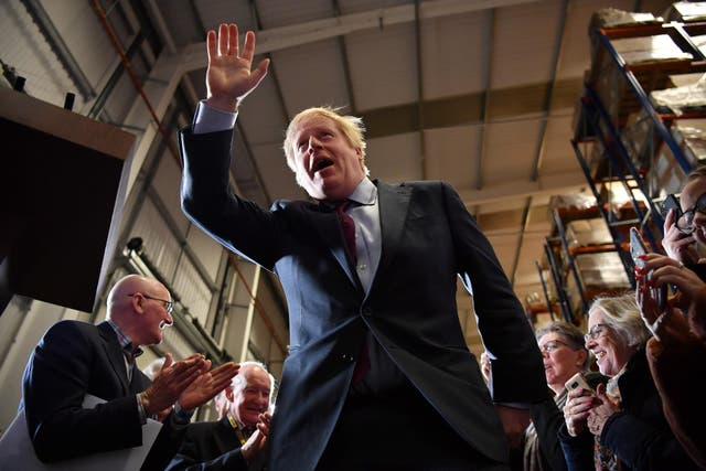 British Prime Minister and Conservative leader Boris Johnson arrives to speak at a general election campaign rally