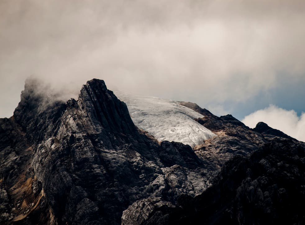 The spectacular mountain Puncak Jaya and the shrinking Carstenz glacier in Mimika Regency, Papua, Indonesia