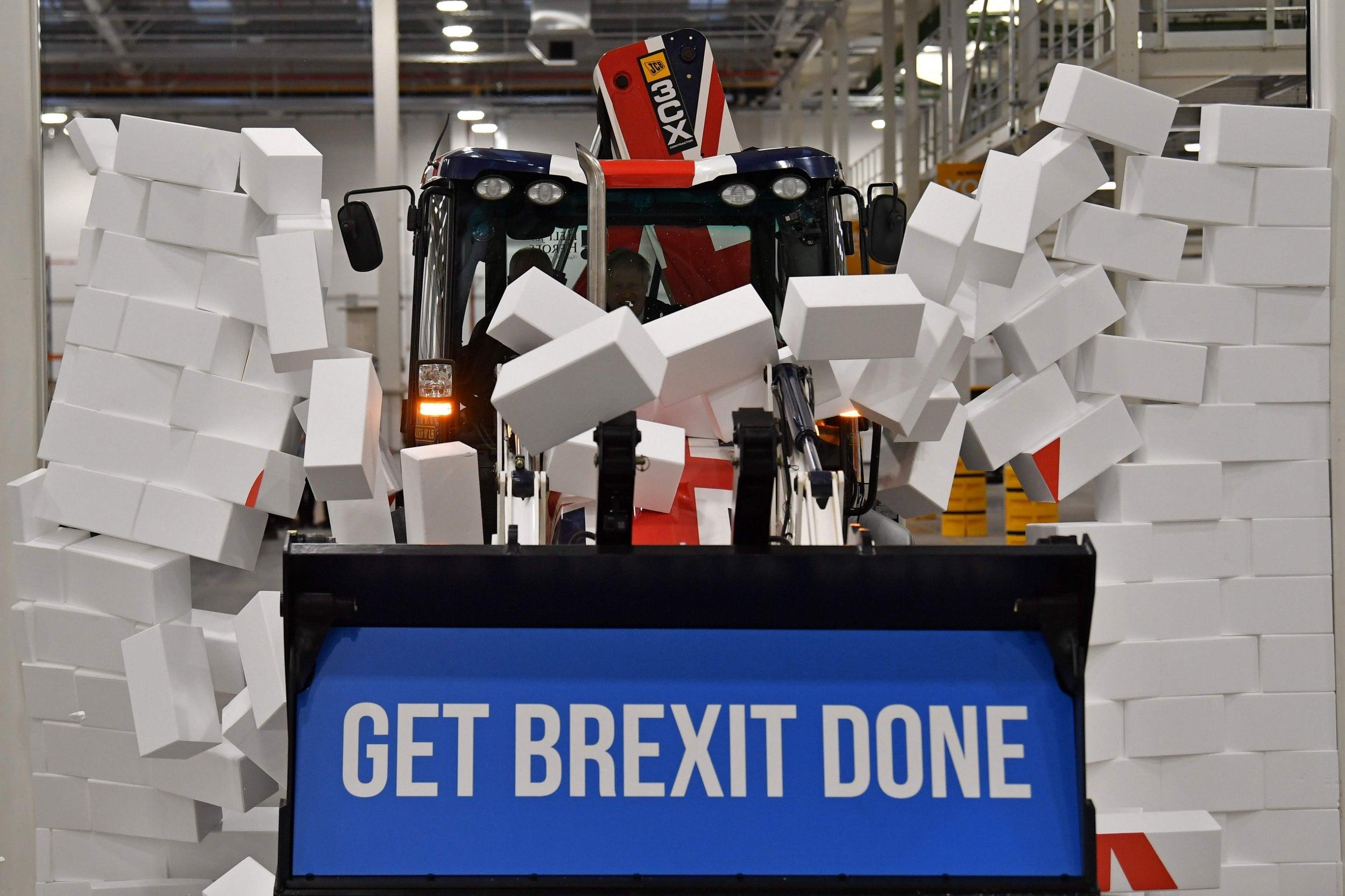 Boris Johnson smashes union flag branded JCB 'Brexit' digger through…