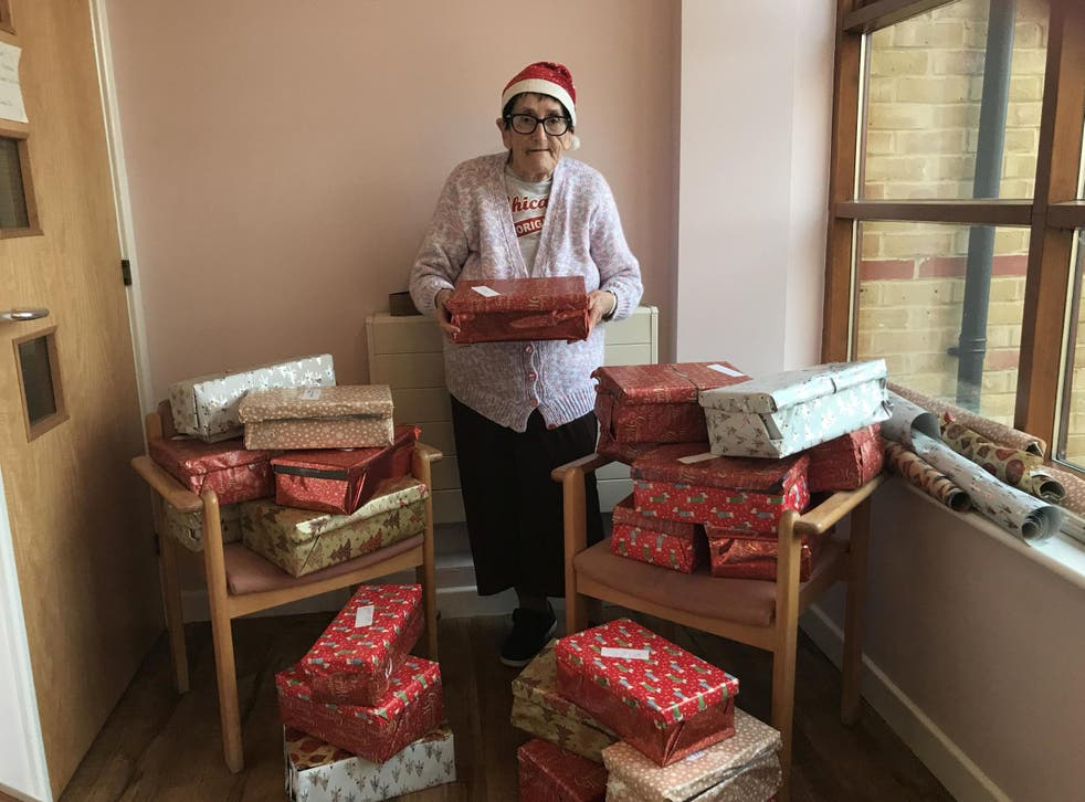 Fran Clark with her Christmas shoeboxes