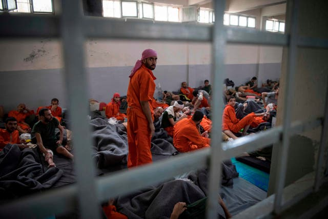 Men allegedly affiliated with Isis sit on the floor in a prison in the northeastern Syrian city of Hassakeh