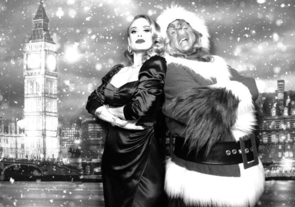 Adele poses with the Grinch in Christmas party snap | The Independent