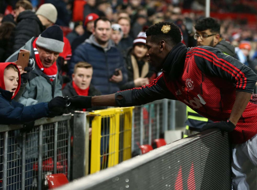 Paul Pogba gives his wristband to a young fan at Old Trafford