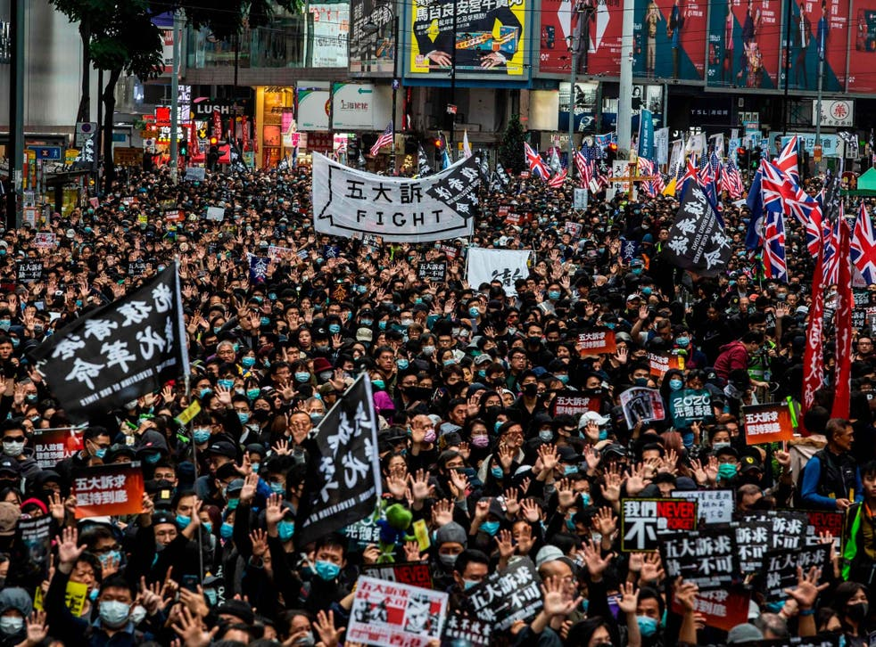 Protesters march in Hong Kong for a pro-democracy rally on 1 January 2020