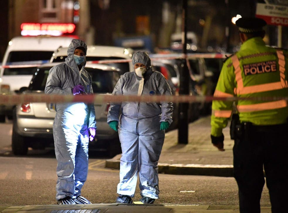 Forensic officers at the crime scene in Finsbury Park after a man was stabbed to death on Friday evening