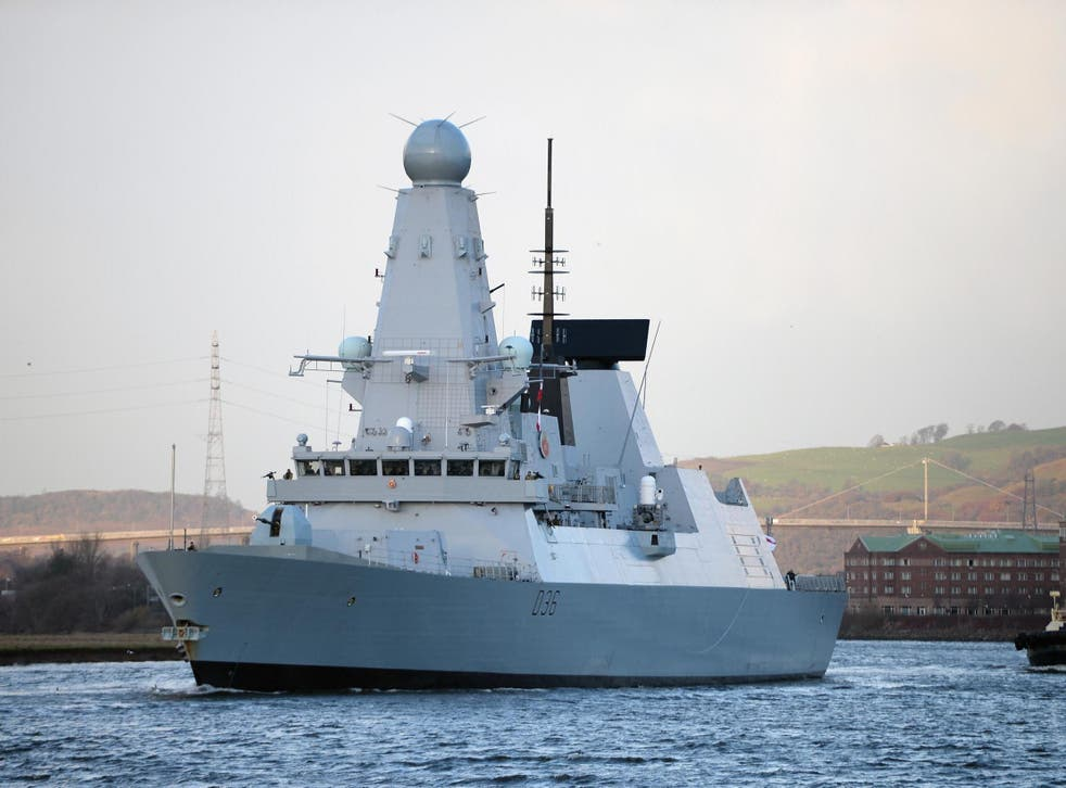 British warship HMS Defender makes its way up the River Clydeon in Glasgow, Scotland, in November 2013.
