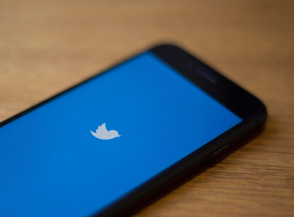 The Twitter logo is seen on a phone in this photo illustration in Washington, DC, on July 10, 2019