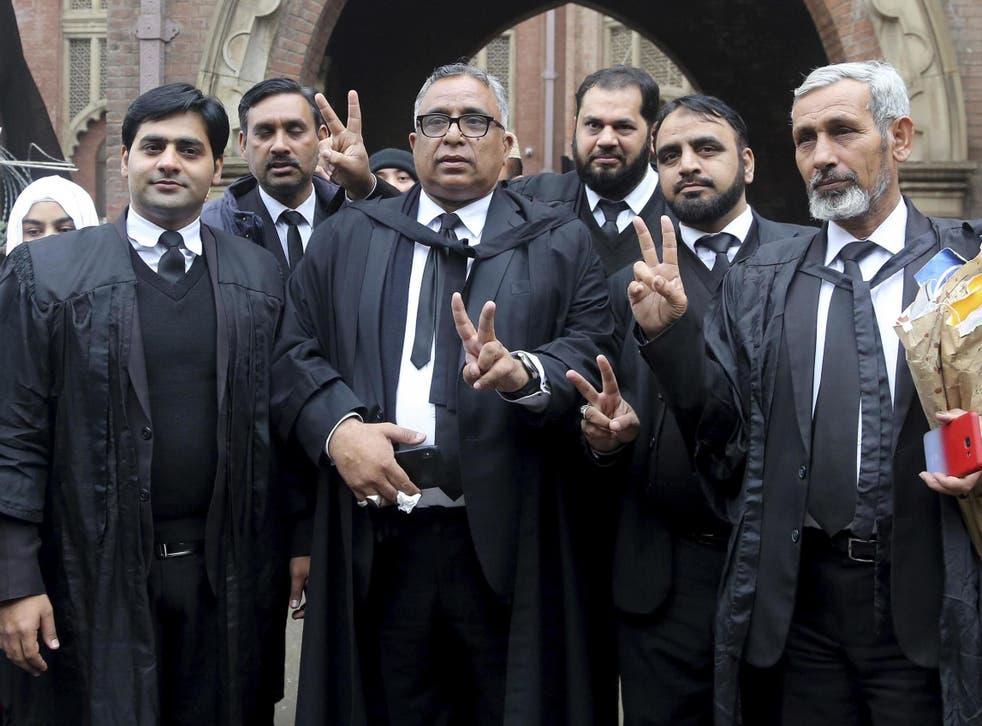Mohammad Azhar Siddique, center, a lawyer for former Pakistani President and military ruler Pervez Musharraf, and other lawyers make a victory sign after the court decision in Lahore Jan 13 2020