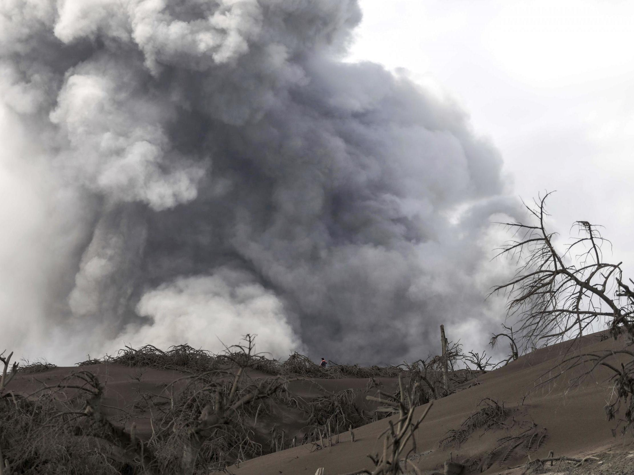 Taal volcano news – live: Tens of thousands flee danger zone amid fears of imminent 'explosive eruption' as towns cloaked in ash