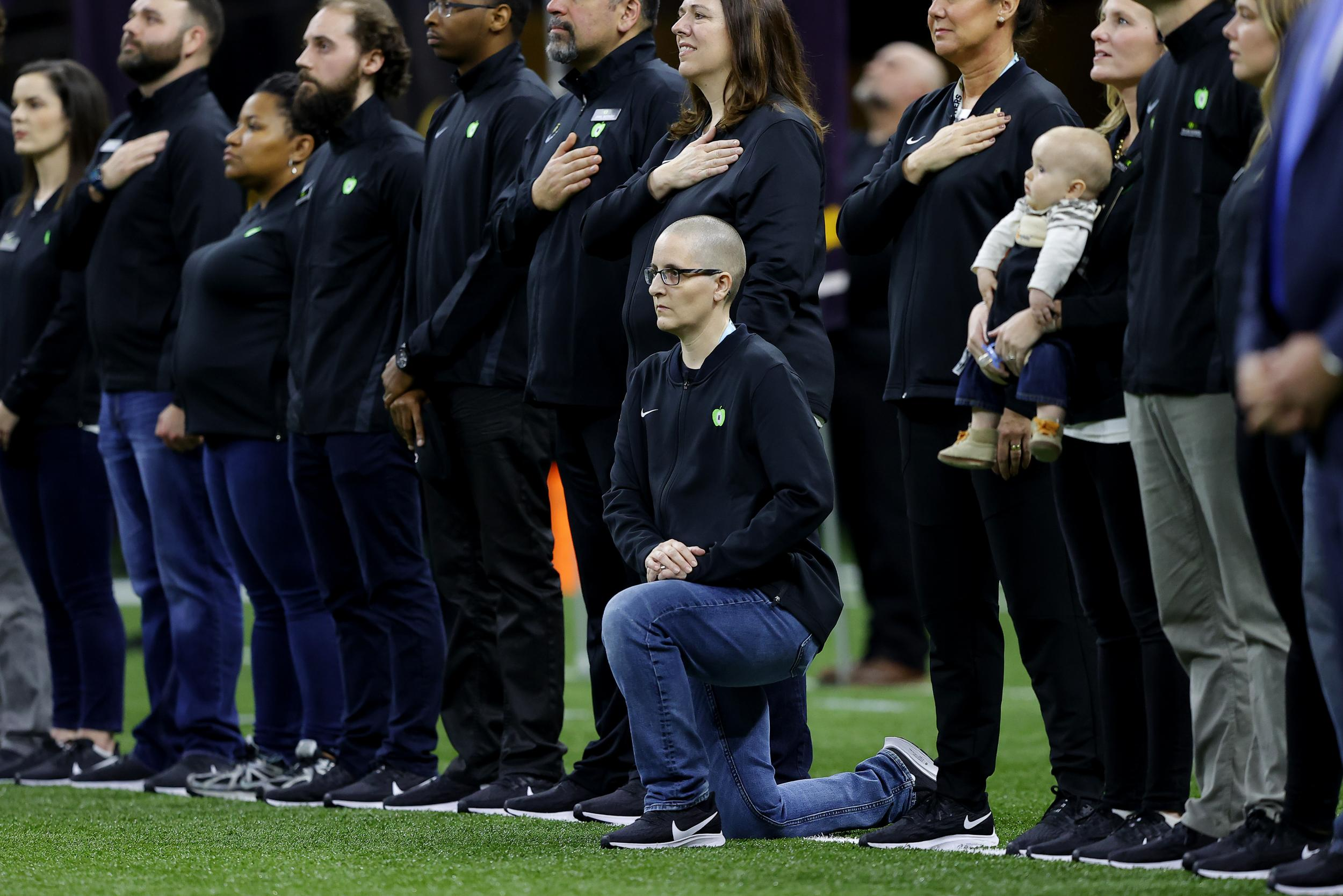 I'm the 'teacher of the year' who took a knee at the football game attended by Trump. This is why I did it