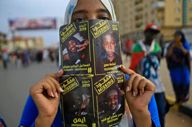 Sudanese protester Ismail, who vanished in June, features on a missing poster