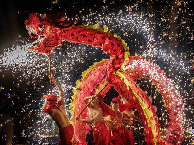 Chinese dragon dancers perform at a fair at a local park on the fifth day of the Chinese Lunar New Year on February 1, 2017 in Beijing, China for the Year of the Rooster