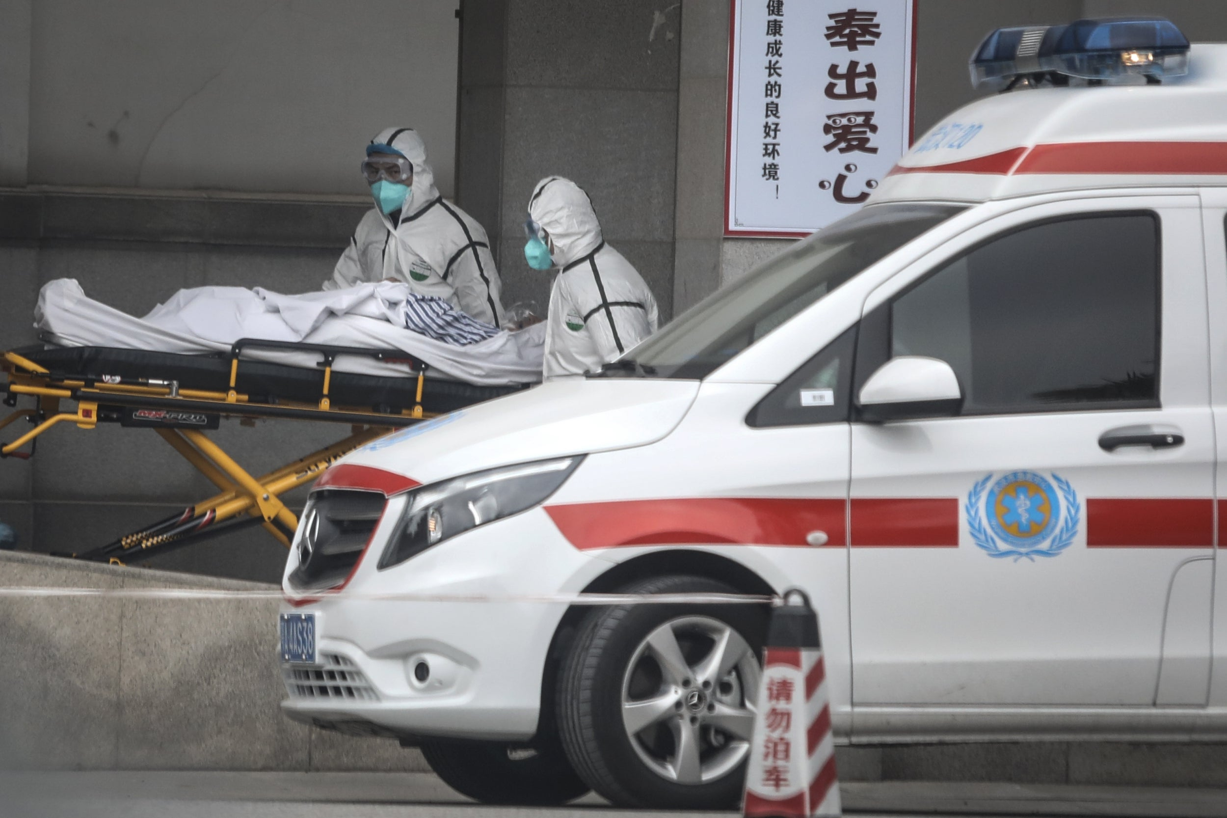 Medical staff transfer patients to Jin Yintan hospital