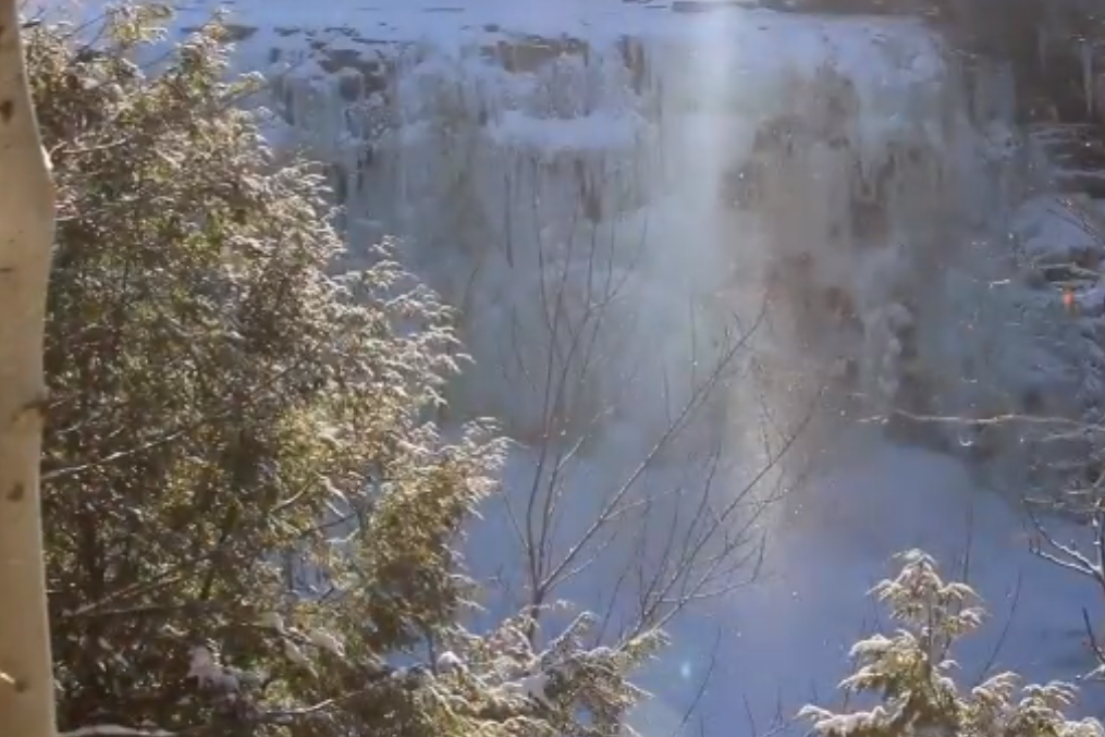 'Diamonds falling from the sky': New York waterfall freezes over in mesmerising video