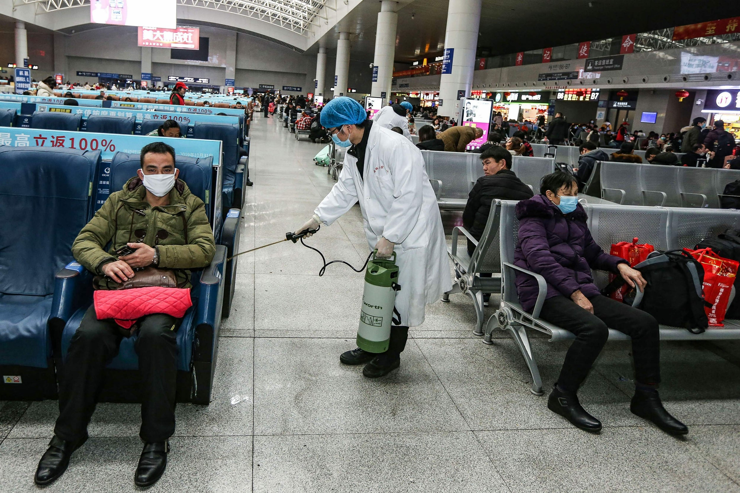Staff disinfecting Yingtan North Railway Station, China