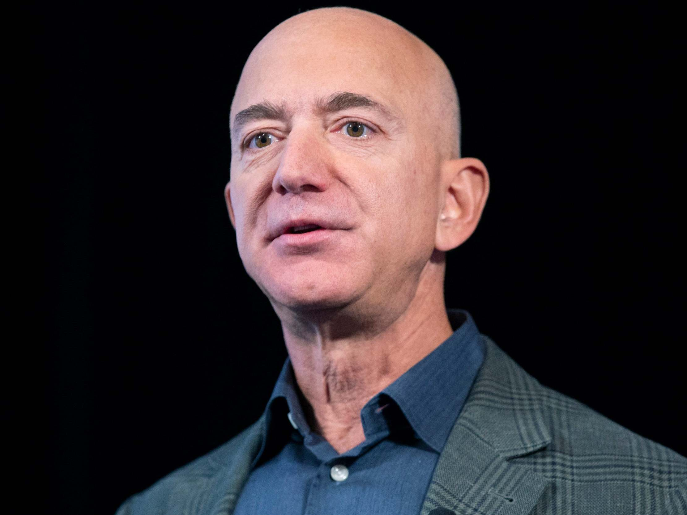 Opinion: Jeff Bezos likes to start fires then cosplay as a firefighter. His $10 billion climate change check is no different
