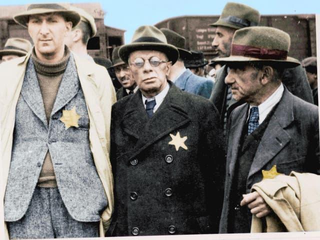 Jewish captives arrive at Auschwitz-Birkenau wearing the Star David